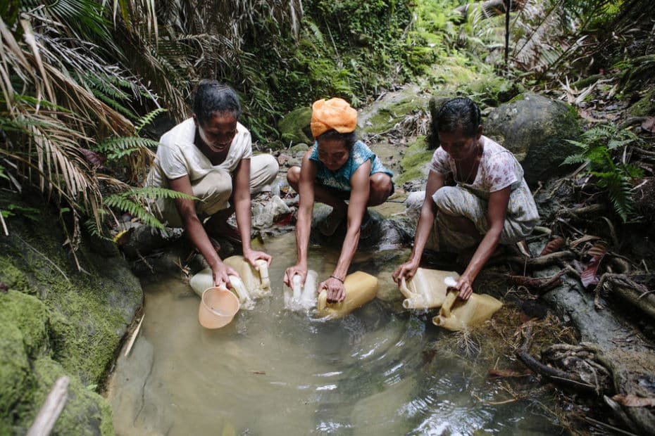 ladies fetching water from stream